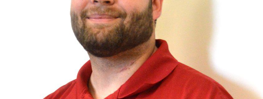 headshot of Adam Wing