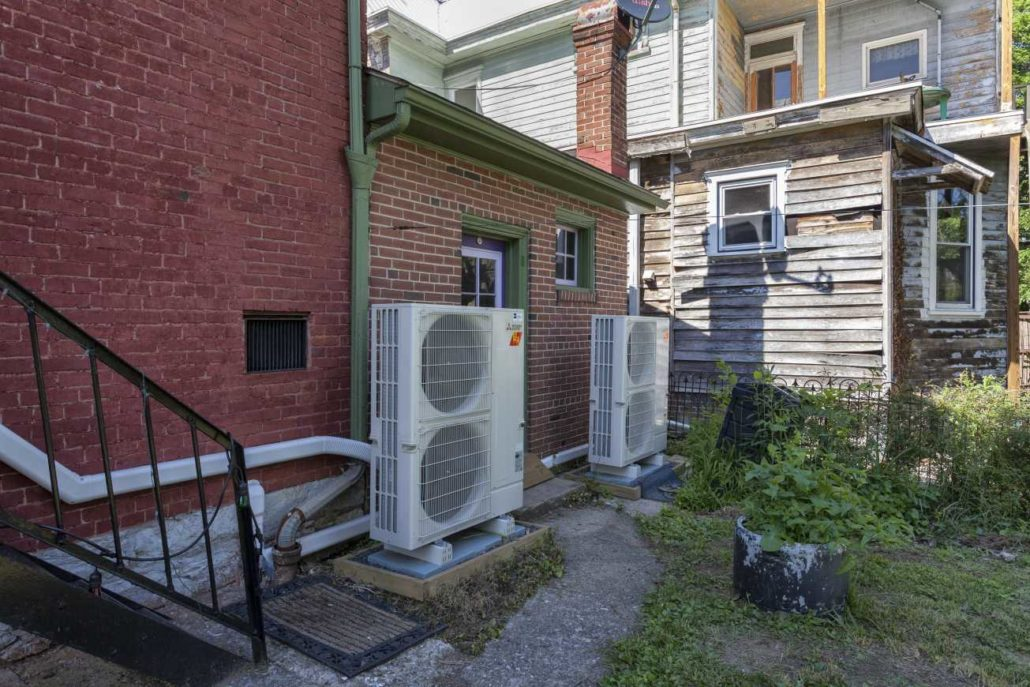 outdoor ductless heat pumps installed outside of a house