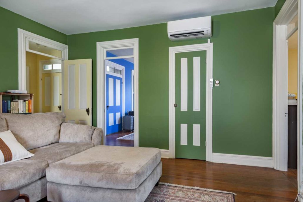 Indoor wall-mount ductless air handler installed in a living room